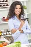 Woman Drinking Red Wine in Home Kitchen Royalty Free Stock Photography
