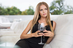 Woman drinking red wine in restaurant Stock Images