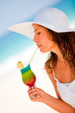 Woman drinking a refreshing beverage Royalty Free Stock Photography