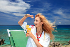 Woman drinking a refreshing beverage Royalty Free Stock Photos