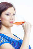 Woman drinking rose wine Stock Photo