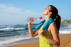 Woman drinking after running royalty free stock image
