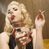Woman drinking and smoking Royalty Free Stock Photography
