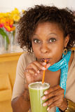 Woman Drinking a Smoothie Stock Photography