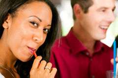 Woman drinking with a straw Stock Photo