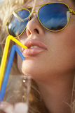 Woman drinking through straw. Royalty Free Stock Image