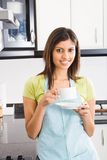 Woman drinking tea Royalty Free Stock Image