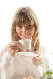 Woman drinking tea. Portrait of young woman drinking tea Royalty Free Stock Photos
