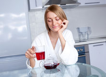 Woman Drinking Tea Stock Images