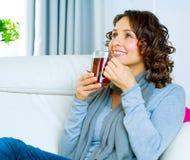 Woman drinking tea. Beautiful Young Woman drinking healthy hot tea Stock Photos