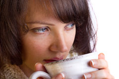 Woman drinking tea. Portrait of young woman drinking tea Royalty Free Stock Images
