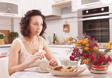 Woman drinking tea. Beautiful girl drinking tea in the morning in the kitchen Stock Photo