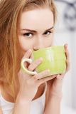 Woman drinking tea in bed Stock Photo