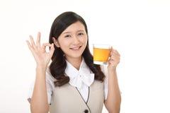 Woman drinking tea. Business woman enjoys cup of tea Stock Image
