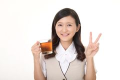 Woman drinking tea. Business woman enjoys cup of tea Royalty Free Stock Image