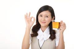 Woman drinking tea. Business woman enjoys cup of tea Royalty Free Stock Photos