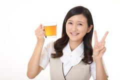 Woman drinking tea. Business woman enjoys cup of tea Stock Photos