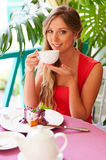 Woman drinking tea in the cafe Stock Photography