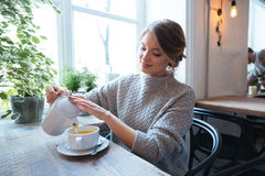 Woman drinking tea in cafe Royalty Free Stock Photos