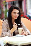Woman drinking tea in a cafe outdoors Stock Photo