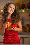 Woman drinking tea in christmas decorated kitchen Royalty Free Stock Image