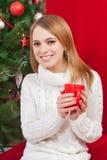 Woman drinking tea at the Christmas tree Stock Photos