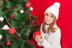 Woman drinking tea at the Christmas tree Stock Images