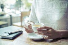Woman drinking tea Royalty Free Stock Image