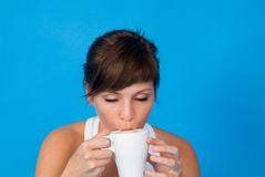 Woman drinking tea or coffee Stock Images