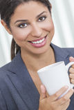 Woman Drinking Tea or Coffee Stock Photo