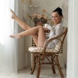 Woman is drinking tea in the morning royalty free stock image