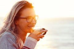 Woman drinking tea outdoors Stock Photo
