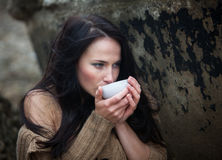 Woman drinking tea outdoors Royalty Free Stock Photos