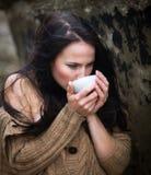 Woman drinking tea outdoors Royalty Free Stock Photo