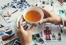 Woman Drinking Tea Photos Memory Concept. Woman Drinking Tea Photos Memory Stock Image