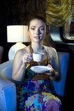 Woman drinking tea in restaurant Royalty Free Stock Image