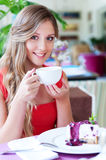 Woman drinking tea and smiling Stock Photo