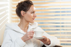 Woman drinking tea in spa. Horizontal view of woman drinking tea in spa Royalty Free Stock Photography
