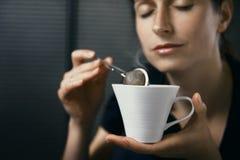 Woman drinking tea royalty free stock photography