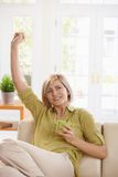 Woman drinking tea and stretching at home Royalty Free Stock Image