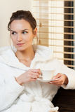 Woman drinking tea before treatment Stock Photography