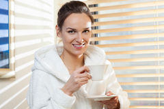 Woman drinking tea after treatment Stock Images