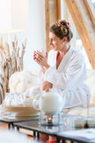 Woman drinking tea in wellness spa Stock Images
