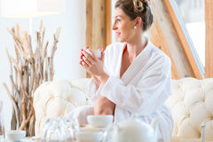 Woman drinking tea in wellness spa Stock Photo