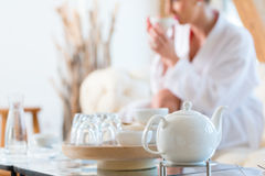 Woman drinking tea in wellness spa