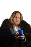 Woman drinking tea in the winter time Stock Image