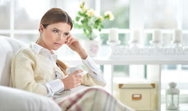 Woman drinking tea Stock Photography
