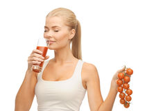 Woman drinking tomato juice Stock Photography