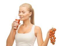 Woman drinking tomato juice Stock Photography
