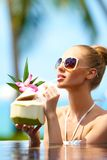Woman drinking tropical cocktail Stock Photo